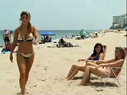 Woman in a bikini getting oogled by two women in bikinis in the Silver Sonic XL commercial