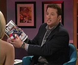 Kevin Trudeau holds a Matthew Lesko book